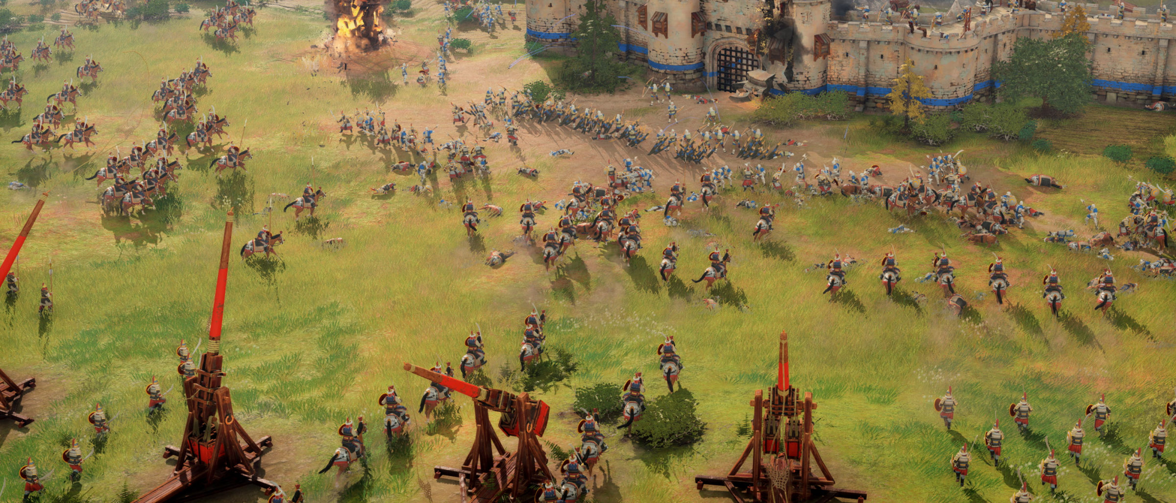 Screenshot of battle scene with trebuchets from Age of Empires game